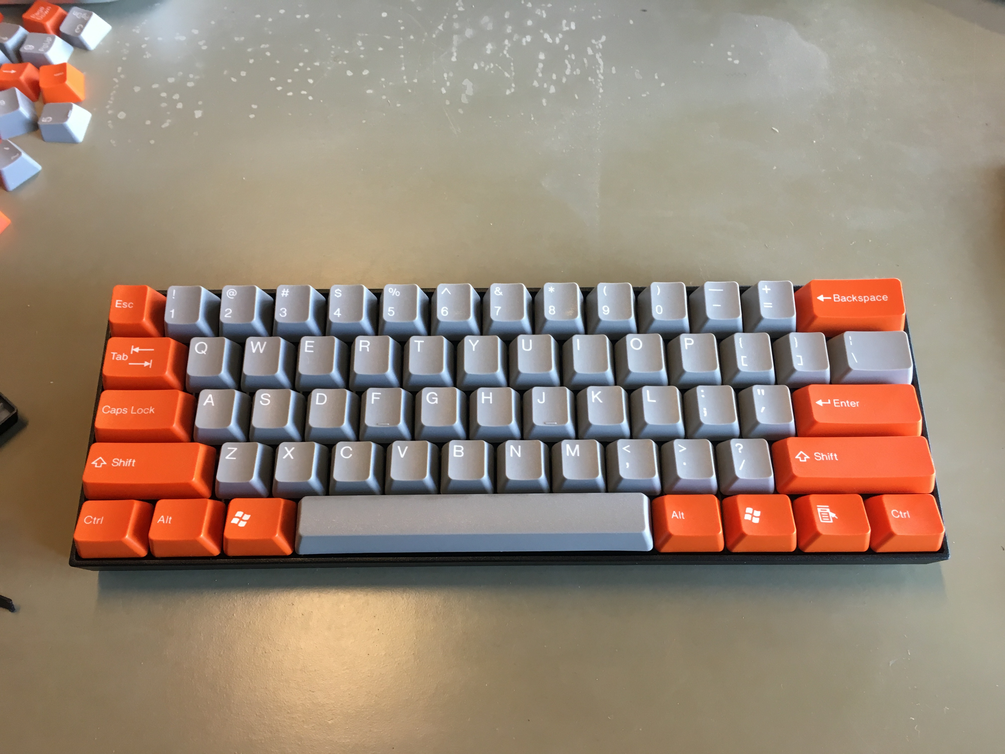 KBParadise V60 with custom orange-grey keycaps