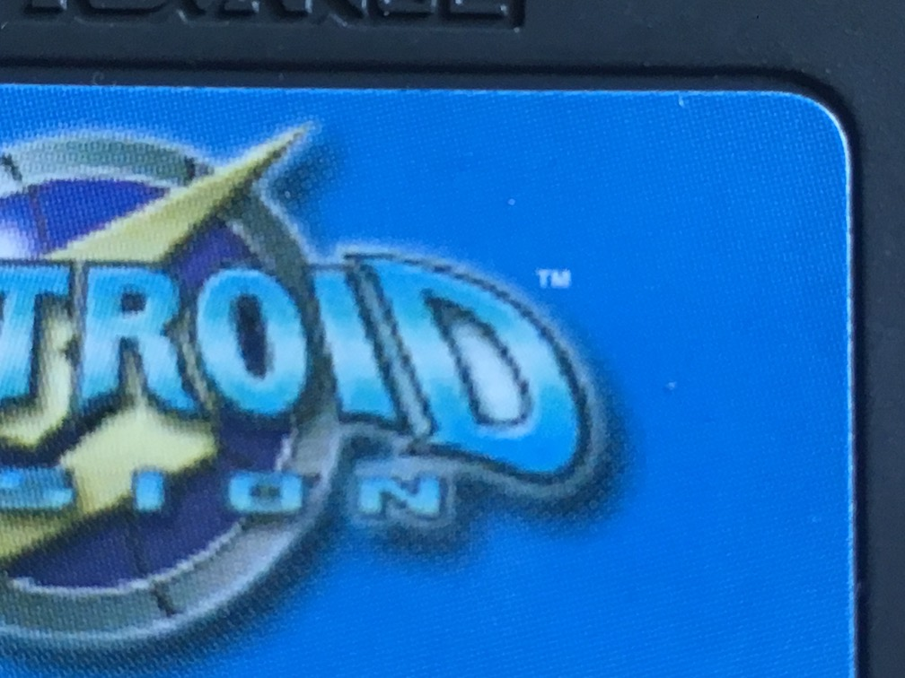 A close-up picture of Metroid Fusion for GBA showing that the logo on the cart is fuzzy
