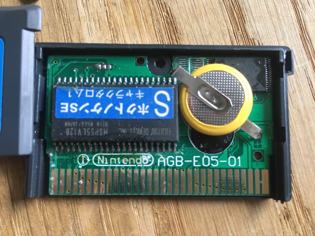 A close-up picture of the circuit board of Metroid Fusion for GBA showing that it's fake